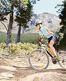A woman mountain biking