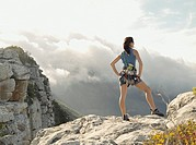 A woman climber on top of a mountain