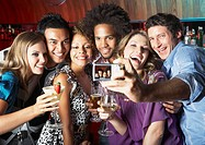 Friends hanging out at a club taking pictures