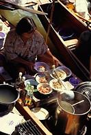 Woman preparing food ´floating market´, Thailand, 1