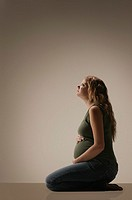 Side view of a pensive pregnant woman