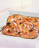 Salmon carpaccio with caviar, capers and lemon dressing