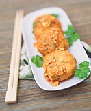 Carp cakes with honey and peanut sauce