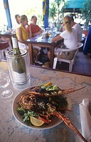 Fried spiny lobster with wine in a hotel Caribbean