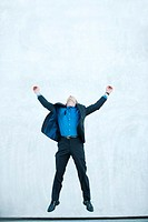 Businessman jumping in air, full length