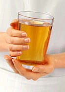 Woman Holding Glass Of Apple Juice