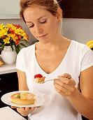Woman In Kitchen Eati Ng Fruit Pastry Tartlet