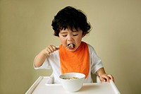 Young boy eating cereal