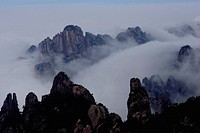 China, Anhui Province, Yellow Mountains, Huang Shan, mountain peaks shrouded in mist and fog
