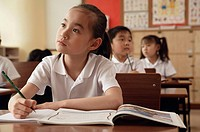 Students in classroom, focus on girl in front