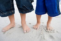 Boys standing on beach