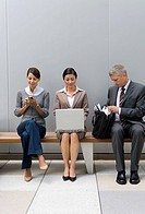 Businesspeople sitting on bench