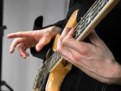 One electric guitar player close up on hands