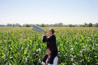 Businesswoman on businessman´s shoulders with megaphone