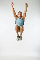 Male Latin athlete jumps in the studio