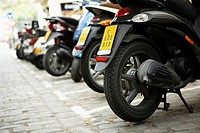 Row of Motorscooters Parked on the Street