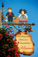 Traditional iron sign, for an Alsatian bread shop, showing a couple in traditional clothing,. Bas-Rhin, Alsace, France