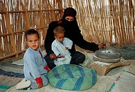 Beduins, woman, with, children, milling, flour, Hurghada, Egypt
