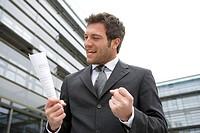 Office buildings, manager, document, hold, joy, jubilation, half mirror image,