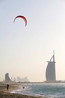 Kite Surfer Standing on the Shoreline with Burj Al Arab in the Background  Dubai, United Arab Emirates
