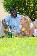 Mixed-Race Couple Relaxing Under a Lemon Tree  Gauteng Province, South Africa