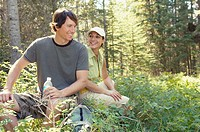 Couple relaxing in the forest