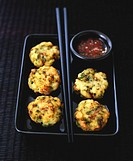 Fish cakes with spicy sauce