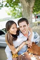 Couple outdoors near convertible car