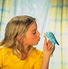 Girl with budgerigar