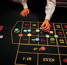 Lifestyle, Business, Gambling, Roulette, Croupier, Hands, Chips on table,