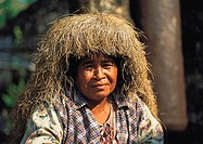 Philippines, Batanes, Ivatan people, Old woman wearing traditional grass Suot hat,