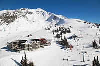 aerial of roundhorse lodge, whistler mountain, whistler peak in background, british columbia, Canada