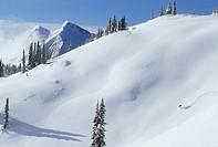 Young man backcountry skiing in Monshee Mountains, Revelstoke, British Columbia, Canada