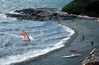 Windsurfer heading towards beach on Dallas Rd, Victoria, Vancouver Island, British Columbia, Canada