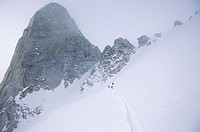 Backcountry Skiers under Snowpatch Spire, Bugaboos, British Columbia, Canada