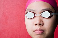 Close-up of a young woman wearing swimming goggles