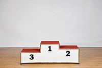Winners podium on a wood laminate flooring