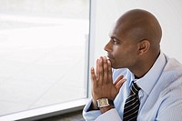 African businessman resting chin on hands