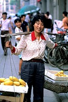 Portrait of a Woman Carrying Fruit, Beijing, China