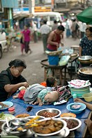 Woman and Baby in a Market, Yangon, Myanmar Burma