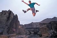 Man Jumping Off a Rock