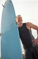 Aging Male Surfer Laughing on the Beach