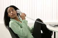 Woman Talking on Phone Looking Over Shoulder
