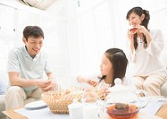 Girl Having Snacks with Parents