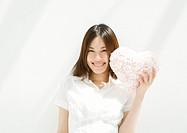 Woman Holding Heart Shaped Cushion