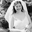 Bride Laughing with Rose in Hand