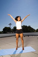 Woman Stretching on Rooftop