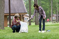 Couple Picking Up Litter