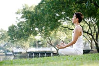 Man meditating in the park