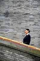 Businesswoman at a stairway
